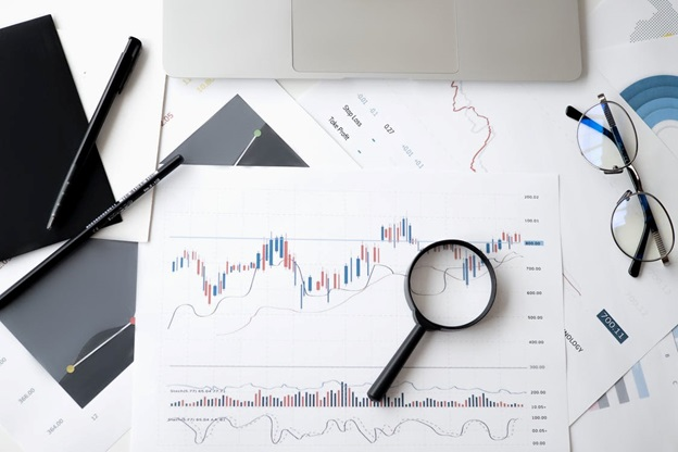 Magnifying glass kept on financial charts